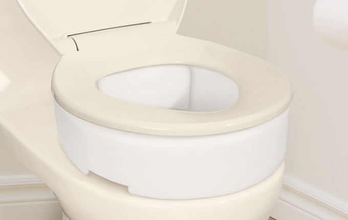 Toilet Seat Riser with Hinge, by AquaSense®, on toilet